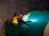 Joe Oliphant checks water depth in the Scapegoat Cave System, Copyright Marc Pederson
