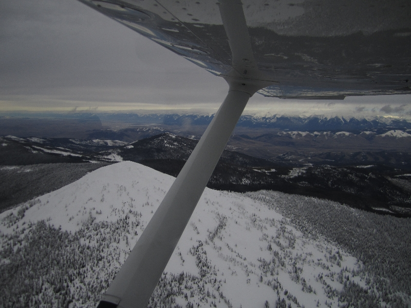 Flying past Ch-Paa-Qn peak, with the Missions Mountains in the background. Copyright Katt McClaine