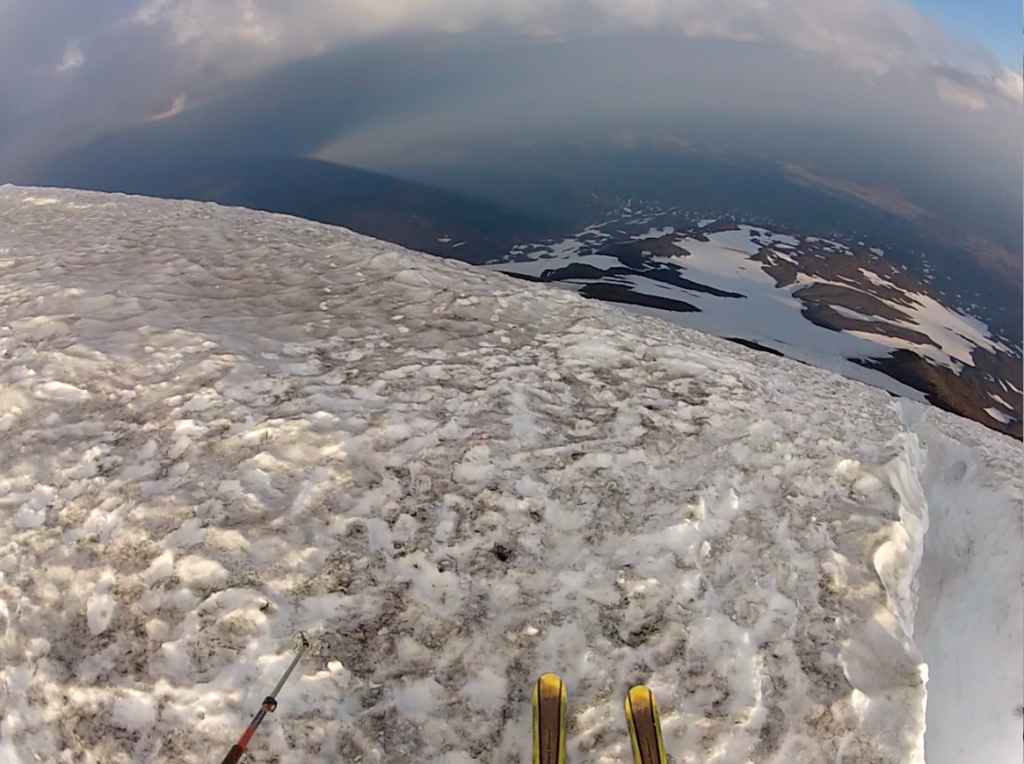 Skiing from the top of Piker's Peak on Mt. Adams with the shadow of the mountain at left.