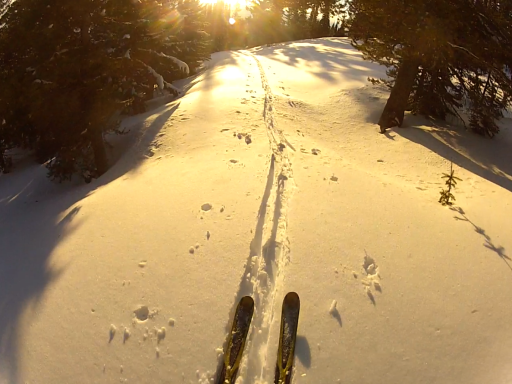 Skiing the road out at sunset.